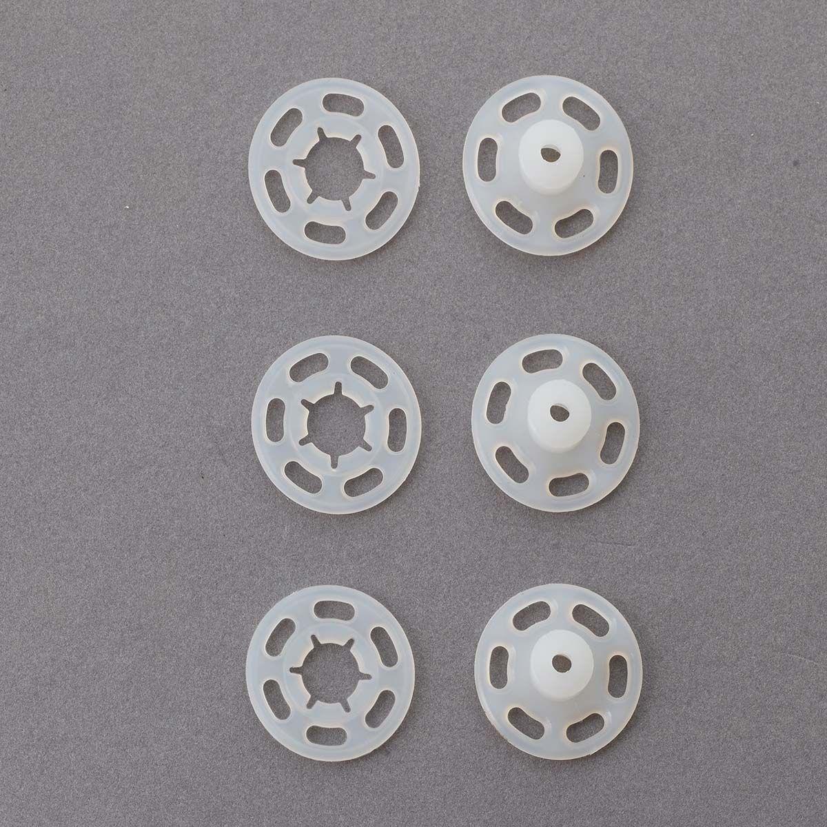 Boutons pression plastiques transparents 7 mm